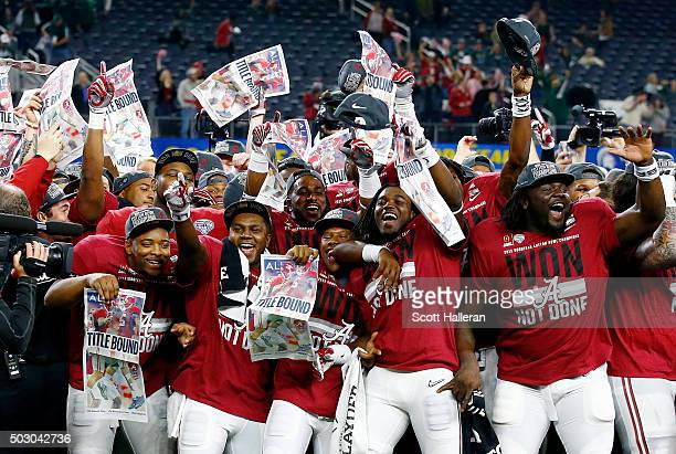 The Alabama Crimson Tide celebrate defeating the Michigan State Spartans 38 to 0 in the Goodyear Cotton Bowl at ATT Stadium on December 31 2015 in...