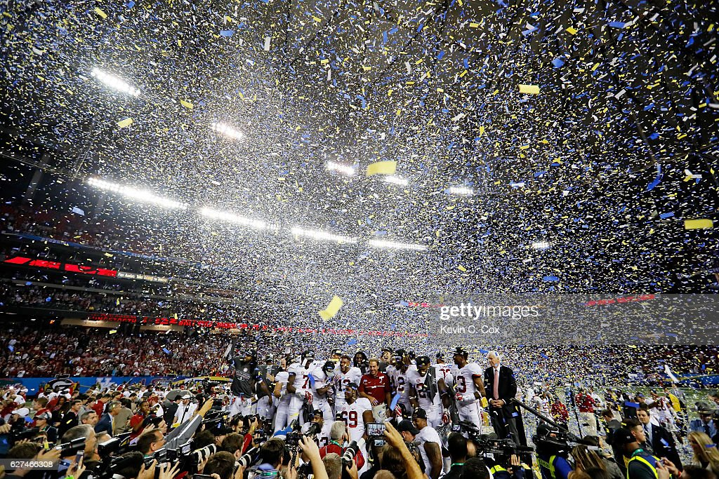 The Alabama Crimson Tide celebrate their 54 to 16 win over the Florida Gators in the SEC Championship game at the Georgia Dome on December 3, 2016 in Atlanta, Georgia.