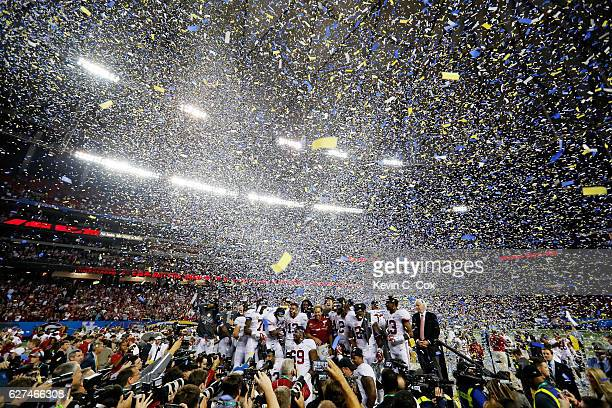 The Alabama Crimson Tide celebrate their 54 to 16 win over the Florida Gators in the SEC Championship game at the Georgia Dome on December 3 2016 in...