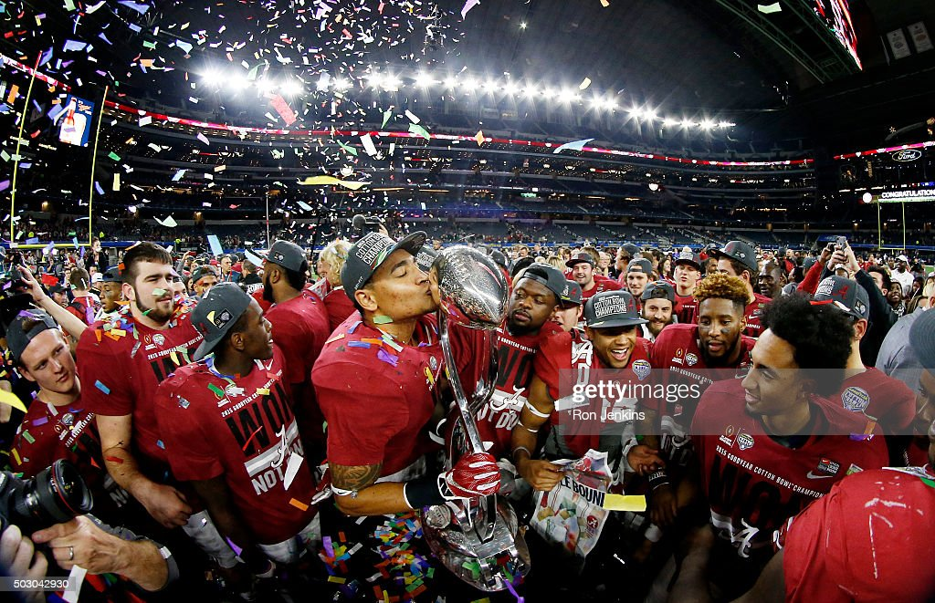 The Alabama Crimson Tide celebrate with the trophy after defeating the Michigan State Spartans 38 to 0 in the Goodyear Cotton Bowl at AT&T Stadium on December 31, 2015 in Arlington, Texas.