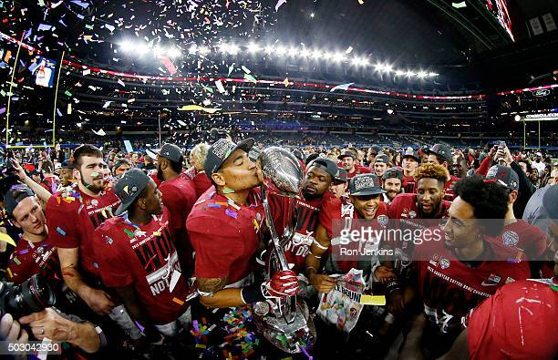 The Alabama Crimson Tide celebrate with the trophy after defeating the Michigan State Spartans 38 to 0 in the Goodyear Cotton Bowl at ATT Stadium on...