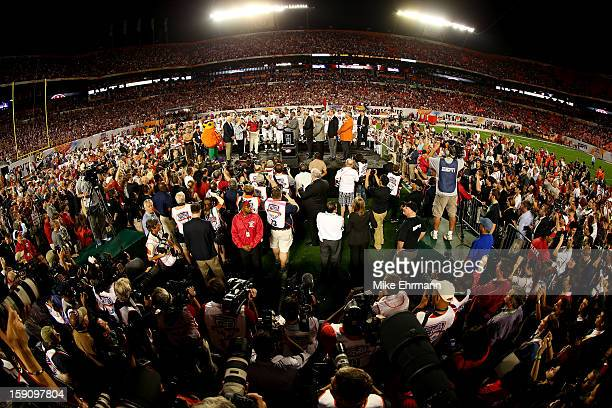 The Alabama Crimson Tide celebrates with the Coach's Trophy after defeating the Notre Dame Fighting Irish by a score of 4214 to win the 2013 Discover...