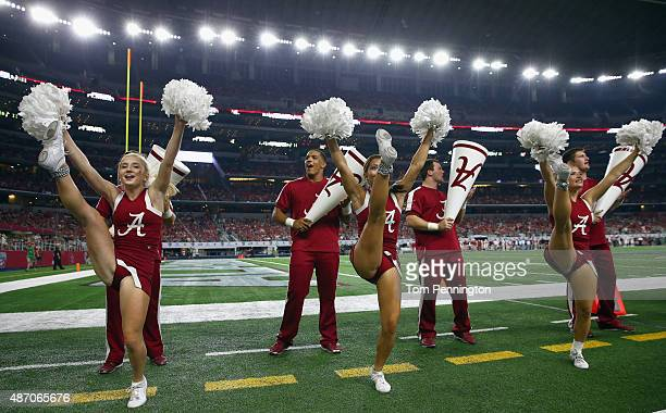 The Alabama Crimson Tide cheerleaders perform as Alabama takes on the Wisconsin Badgers during The Advocare Classic at ATT Stadium on September 5...