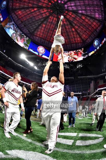 The Alabama Crimson Tide cheerleaders perform prior to their game against the Florida State Seminoles at MercedesBenz Stadium on September 2 2017 in...