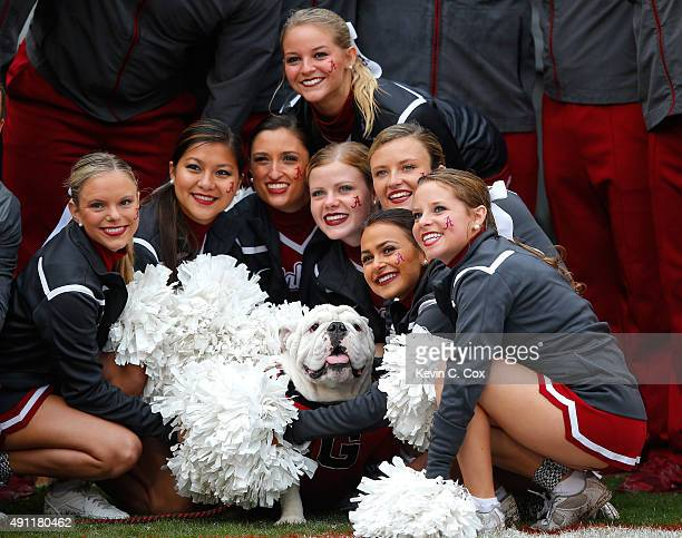 The Alabama Crimson Tide cheerleaders pose with the mascot Que prior to the game between the Alabama Crimson Tide and the Georgia Bulldogs at Sanford...