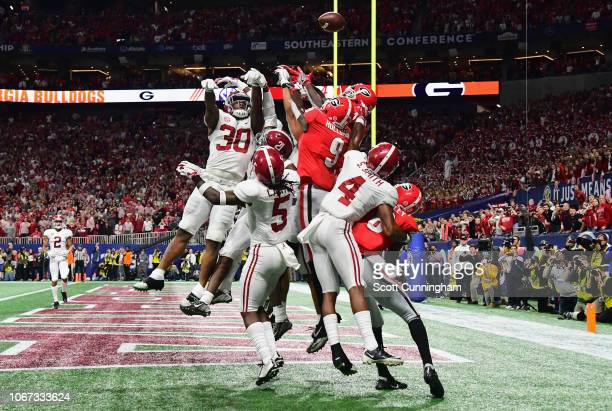 The Alabama Crimson Tide defense breaks up a hail mary pass attempt in the fourth quarter against the Georgia Bulldogs during the 2018 SEC...