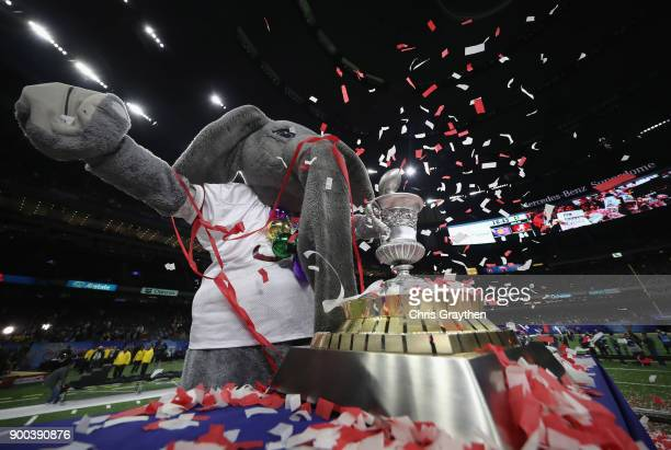 The Alabama Crimson Tide mascot celebrates with the trophy after the AllState Sugar Bowl against the Clemson Tigers at the MercedesBenz Superdome on...
