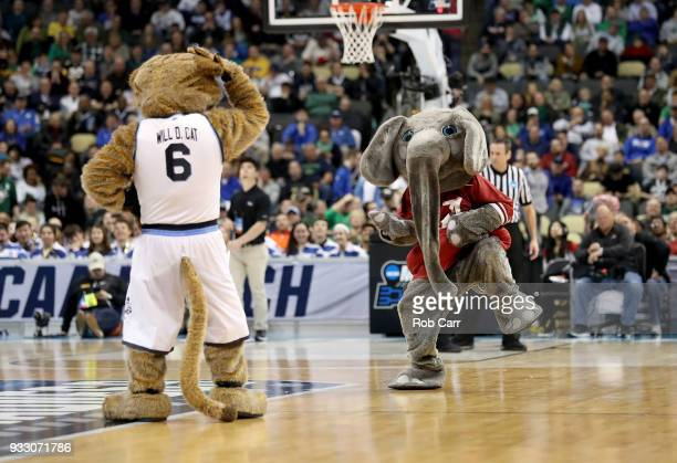 The Alabama Crimson Tide mascot performs against the Villanova Wildcats mascot during the second half in the second round of the 2018 NCAA Men's...