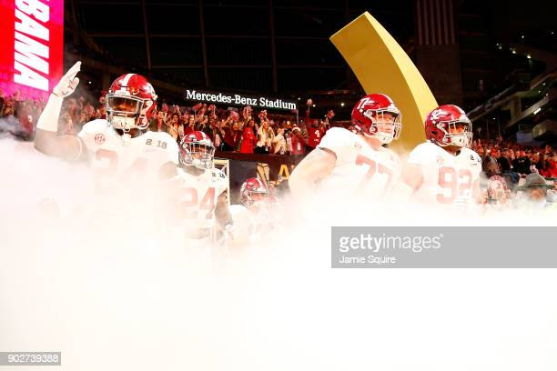 The Alabama Crimson Tide runs out of the tunnel prior to the game against the Georgia Bulldogs in the CFP National Championship presented by ATT at...