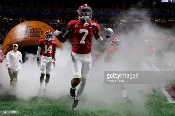 The Alabama Crimson Tide take the field against the Florida State Seminoles prior to their game at Mercedes-Benz Stadium on September 2, 2017 in...