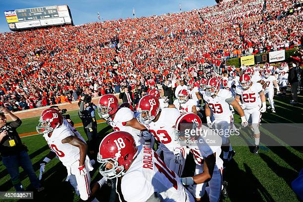 The Alabama Crimson Tide take the field for their game against the Auburn Tigers at JordanHare Stadium on November 30 2013 in Auburn Alabama