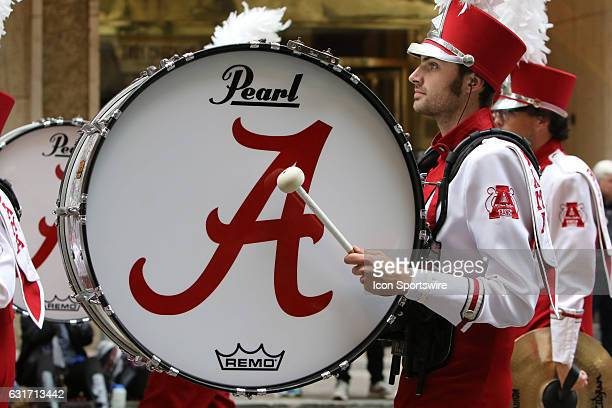 The Alabama Million Dollar Band marches in the Peach Bowl Parade during the College Football Playoff Semifinal at the ChickfilA Peach Bowl between...