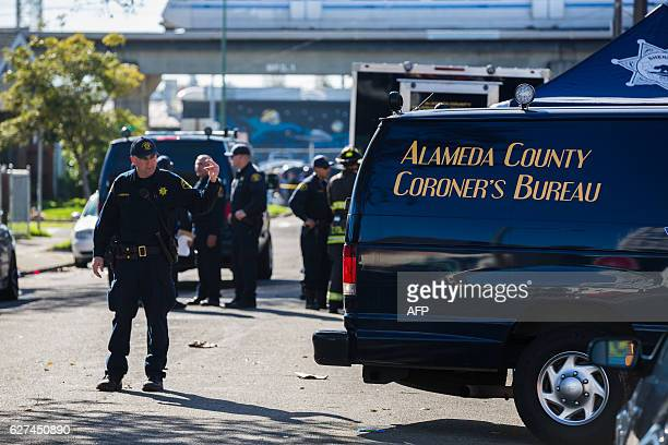 The Alameda County coroner's van is seen near a warehouse after it was destroyed by a fire December 3 2016 in Oakland California Up to 40 people were...