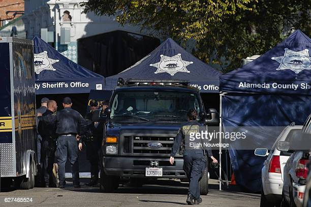 The Alameda County Sheriff's Department Coroner's Bureau sets up outside the scene following an overnight fire that claimed the lives of at least...
