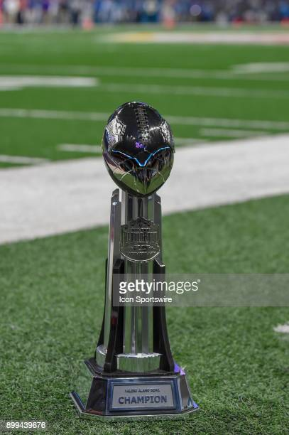 The Alamo Bowl Championship trophy awaits the winner on the sideline late in the 4th quarter during the Alamo Bowl game between the Stanford...