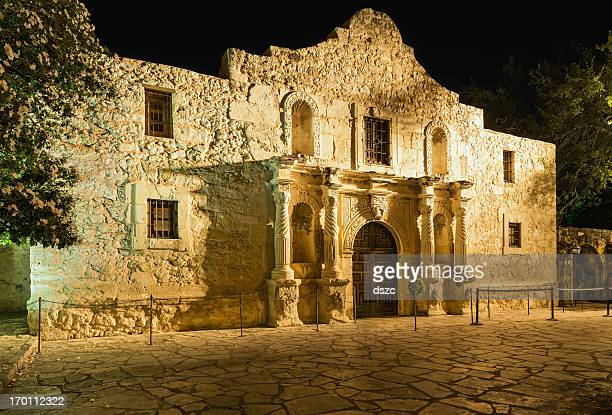 the alamo  san antonio texas, in golden incandescent nighttime light - alamo stock pictures, royalty-free photos & images