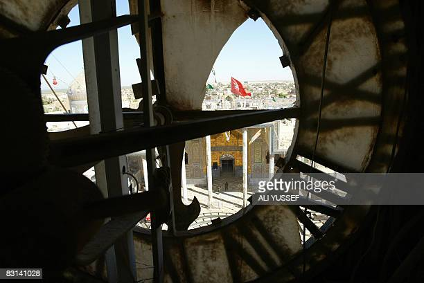 The AlAskari mosque in Samarra is photographed through the broken face of a nearby clocktower on October 4 2008 The mausoleum at the thousandyearold...