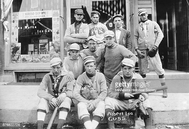 The Albert Lea Cubs minor league baseball team poses for a portrait on a sidewalk in the town