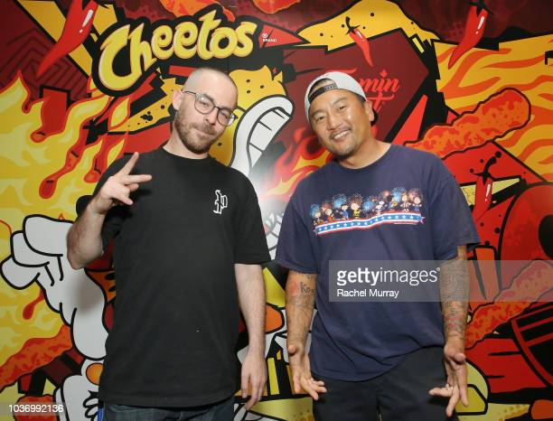 The Alchemist and Roy Choi attend The Flamin Hot Spot Cheetos new limitedtime restaurant with a menu inspired by chef Roy Choi at Madera Kitchen on...