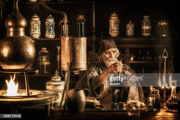 the alchemist - ancient stock pictures, royalty-free photos & images