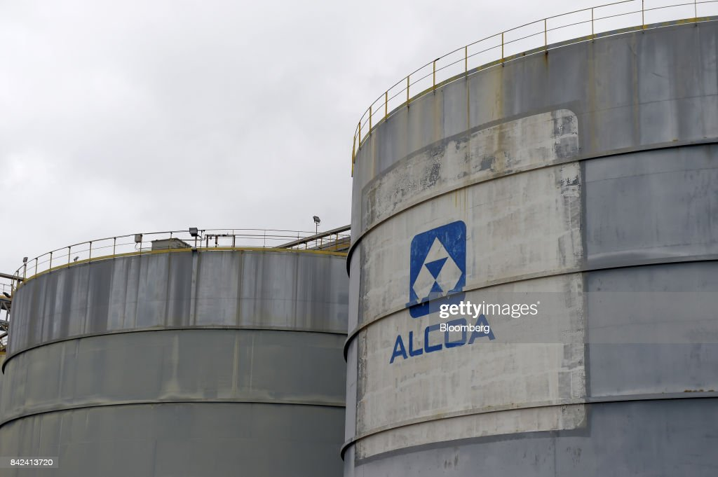 The Alcoa Corp  logo is displayed on a storage tank at the