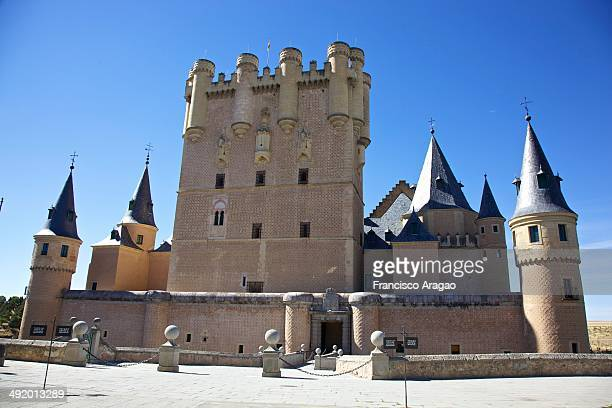 The Alcázar of Segovia is a stone fortification, located in the old city of Segovia, Spain. Rising out on a rocky crag above the confluence of the...