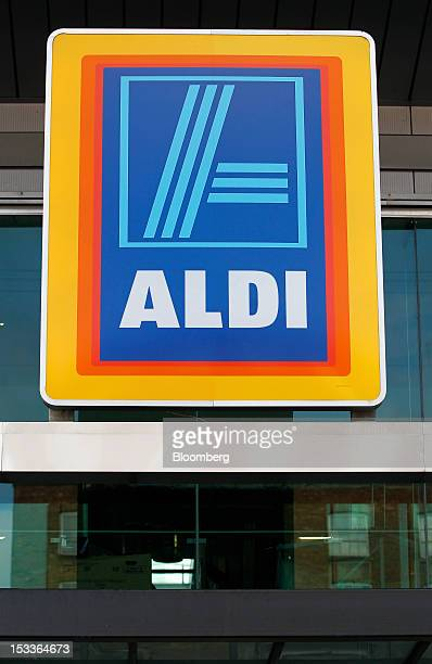 The Aldi logo sits outside a supermarket operated by Aldi Group Germany's biggest discountfood retailer in this arranged photograph in Manchester UK...