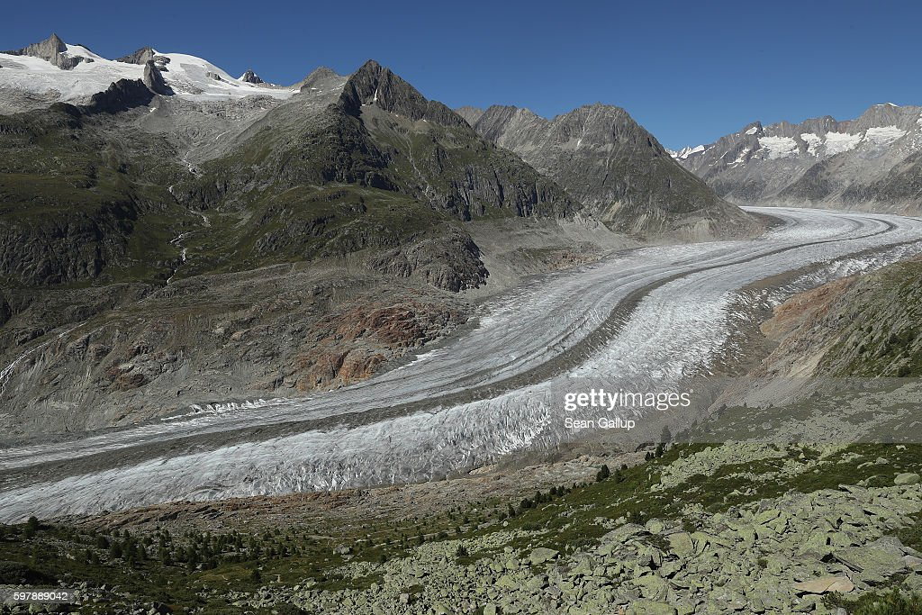 The Aletsch glacier stretches below in a view from a trail below the Bettmerhorn peak on August 24, 2016 near Bettmeralp, Switzerland. The Aletsch glacier, today approximately 23km long and up to 900 meters deep, is Switzerland's largest glacier and is shrinking rapidly. While glaciers across Europe have been receding since approximately the 1870s, the process has accelerated since the early 1980s, a phenomenon many scientists attribute to global warming. The European Enivironmental Agency predicts the volume of European glaciers will decline by between 22% and 89% by 2100, depending on the future intensity of greenhouse gases.