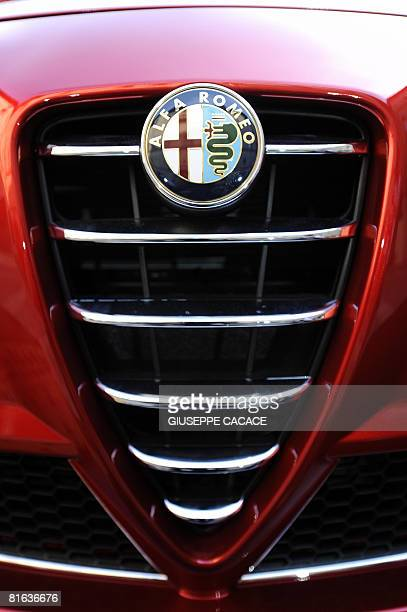 The Alfa Rome logo is seen in front of the new Alfa Romeo Mito car shown at the Sforzesco castle during a press conference to present the new model...