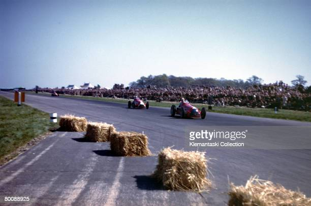 The Alfa Romeo 159 of Giuseppe Farina leading the sister car driven by Luigi Fagioli during the British Grand Prix at Silverstone, 13th May 1950.