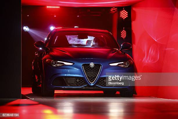 The Alfa Romeo Giulia vehicle is unveiled during Automobility LA ahead of the Los Angeles Auto Show in Los Angeles California US on Wednesday Nov 16...
