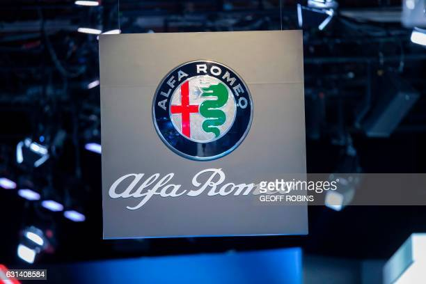 The Alfa Romeo sign hangs above the company's booth at the 2017 North American International Auto Show in Detroit Michigan January 10 2017 / AFP...