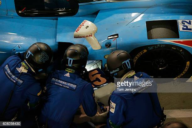 The Algarve Pro racing team mechanics try to solve a mechanical problem in the night that caused them to lose time during the Le Mans 24 hour...