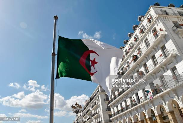 The Algerian flag is seen at half mast in the capital Algiers on April 12 2018 after the president declared three days of national mourning over a...