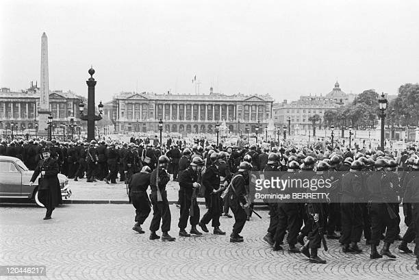 The Algerian War In Paris France In May 13 1958 Demonstration in favor of a French Algeria on the Champs ElyseesState Policemen at Concorde place...