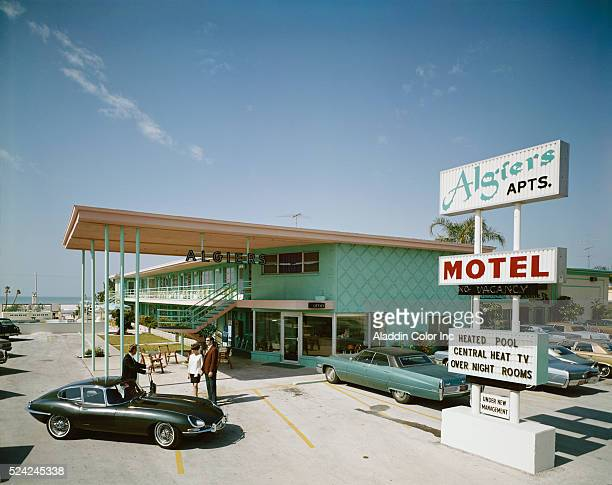 The Algiers Apartments Motel with a Jaguar XKE out front