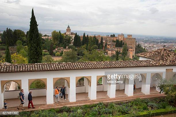 The Alhambra Palace and fortress complex located in Granada Andalucia Spain View over the gardens from Genaralife area towards the Church of Santa...