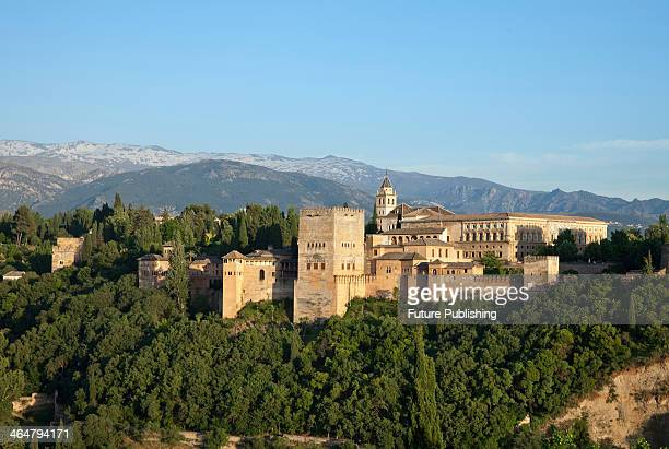 The Alhambra palace complex in Granada Spain with the Sierra Nevada mountains visible in the background taken on June 11 2013 Alhambra was a Moorish...