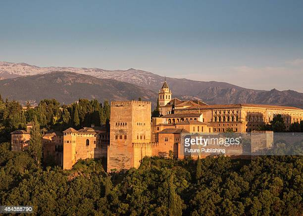 The Alhambra palace complex in Granada Spain with the Sierra Nevada mountains visible in the background taken on June 11 2013