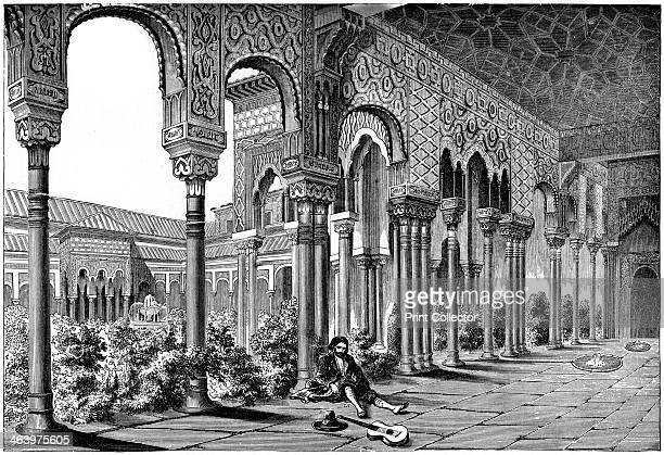The Alhambra Palace Granada Spain View of colonnades and courtyard in the fortress palace of the Moorish kings built 13th to 14thcentury An engraving...