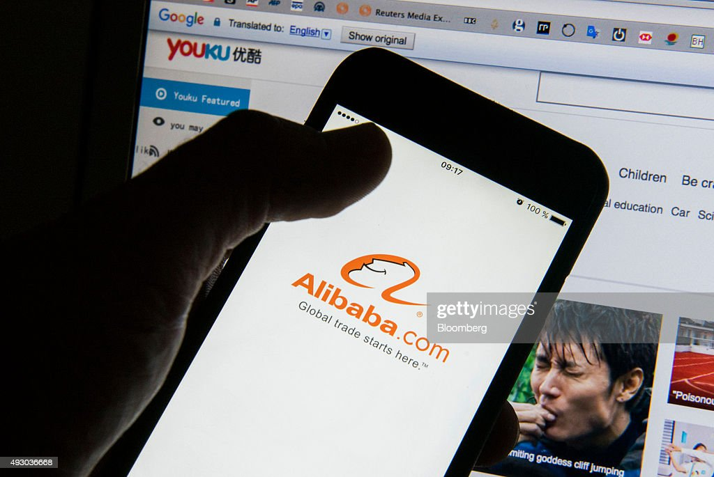 Alibaba Group Holding Ltd. And Youku Tudou Inc. Illustrations As Alibaba Makes Offer For The Rest of Youku Video Site : News Photo