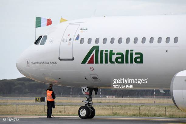 The Alitalia plane transporting Pope Francis for a twodays visit in Egypt prepares to takeoff on April 28 2017 at Rome's Fiumicino airport / AFP...