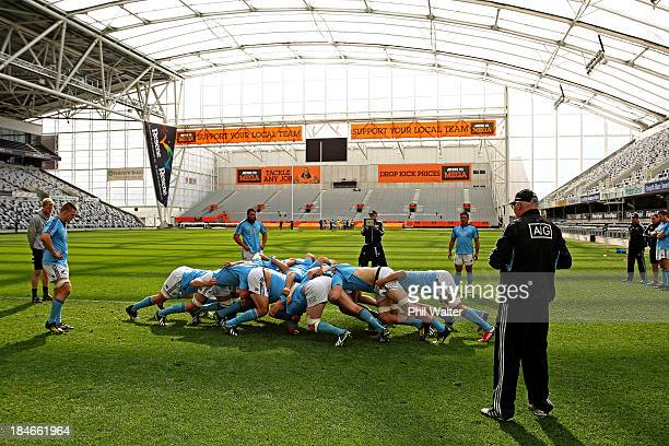 The All Black forwards practice the scrum during a New Zealand All Blacks training session at the Forsyth Barr Stadium on October 15, 2013 in...