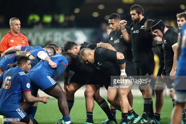 The All Black front row pack down for a scrum during the International Test match between the New Zealand All Blacks and France at Forsyth Barr...
