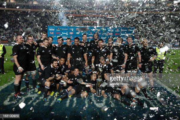 The All Blacks celebrate after winning the inaugural Rugby Chamionship after their victory in the Rugby Championship match between Argentina and the...