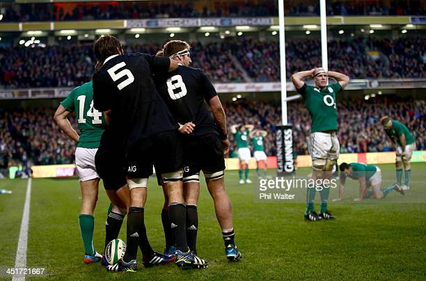 The All Blacks celebrate Ryan Crotty's try during the International match between Ireland and the New Zealand All Blacks at Aviva Stadium on November...
