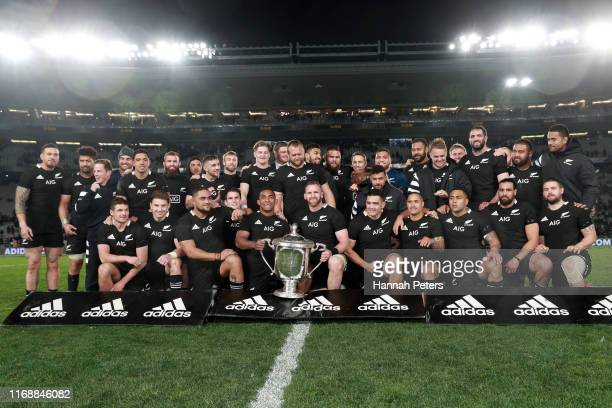 The All Blacks celebrate with teh Bledislow Cup after winning the 2019 Rugby Championship Test Match between the New Zealand All Blacks and the...