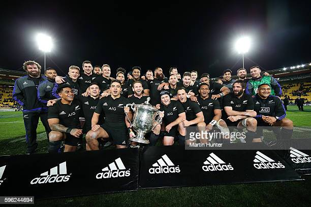 The All Blacks celebrate with the Bledisloe Cup after the Bledisloe Cup Rugby Championship match between the New Zealand All Blacks and the Australia...