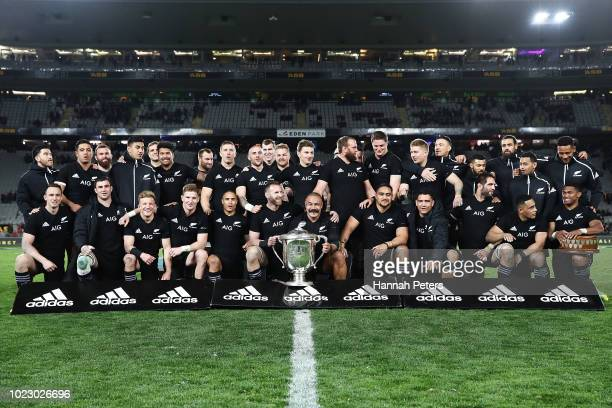 The All Blacks celebrate with the Bledisloe Cup after winning The Rugby Championship game between the New Zealand All Blacks and the Australia...