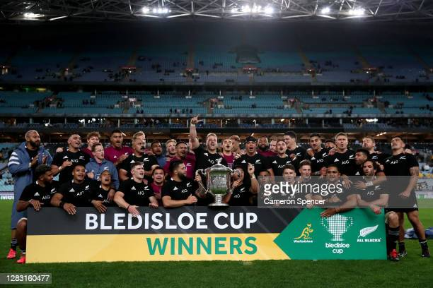 The All Blacks celebrate with the Bledisloe Cup after winning the 2020 Tri-Nations and Bledisloe Cup match between the Australian Wallabies and the...